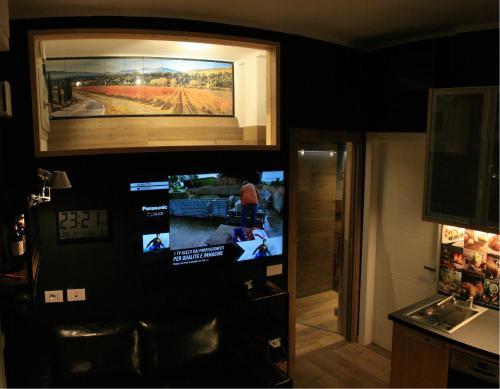 Een TV en/of entertainmentcenter bij B&B Tuscany Gallery