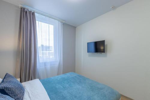 A bed or beds in a room at InHome24 Sky Way Studios