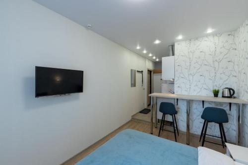 A television and/or entertainment centre at InHome24 Sky Way Studios