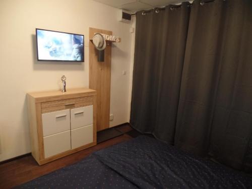 TV a/nebo společenská místnost v ubytování Apartmány City