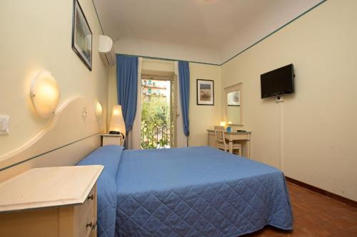 A bed or beds in a room at Hotel Crocini