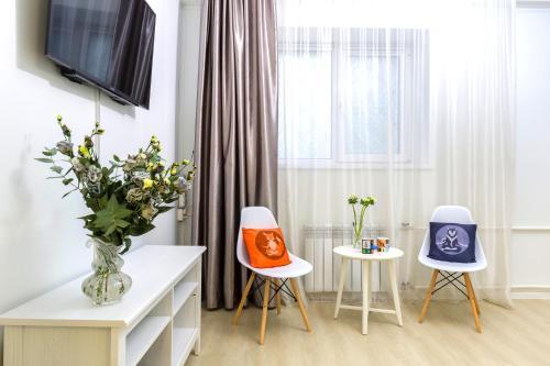 Телевизор и/или развлекательный центр в On Nevsky Prospekt Apartment