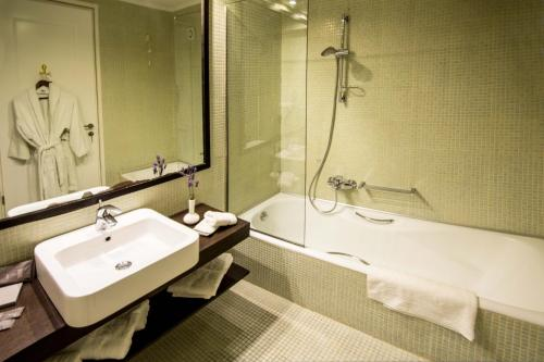 A bathroom at Mabely Grand Hotel