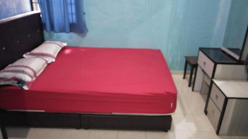 Katil atau katil-katil dalam bilik di Homestay Taman Maju Jasin