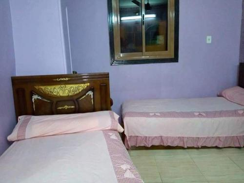 A bed or beds in a room at El-amin