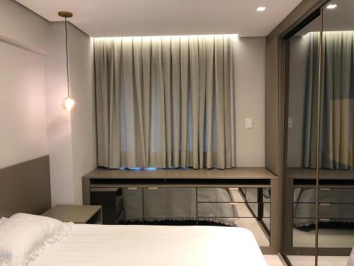 A bed or beds in a room at Apartamento 50 mt praia de Balneario Camboriu