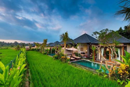The swimming pool at or close to Bliss Ubud Spa Resort