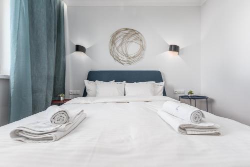 Postel nebo postele na pokoji v ubytování Apartament Zielna by Your Freedom