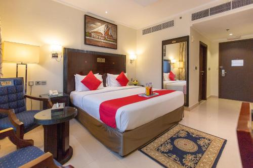 A bed or beds in a room at Smana Hotel Al Raffa
