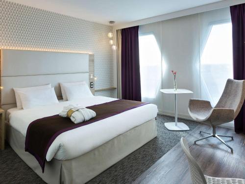 Cama ou camas em um quarto em Mercure Paris Orly Rungis Aéroport