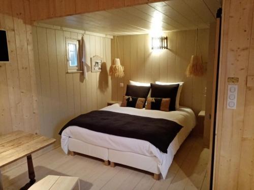 Un ou plusieurs lits dans un hébergement de l'établissement Quetsche et mirabelle