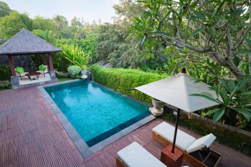 The swimming pool at or close to Sanctoo Suites & Villas