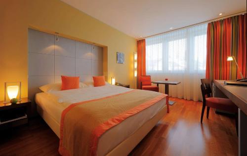 Ein Bett oder Betten in einem Zimmer der Unterkunft Radisson Blu Hotel, St. Gallen