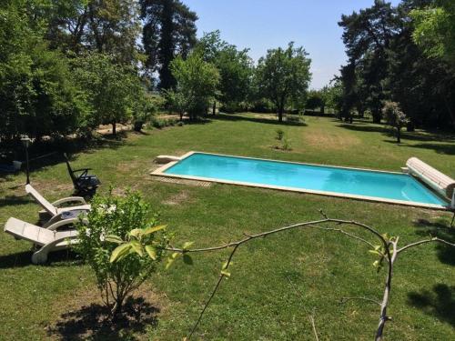 The swimming pool at or near Gite du Calme
