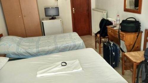Ένα ή περισσότερα κρεβάτια σε δωμάτιο στο Hotel Marmarinos