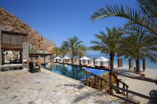 The swimming pool at or near Six Senses Zighy Bay