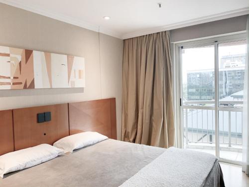 A bed or beds in a room at CaviRio - Excelente suíte