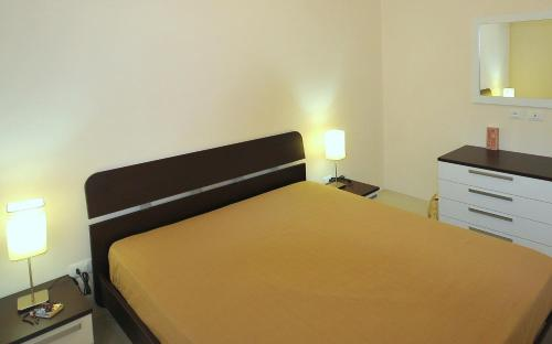 A bed or beds in a room at Villa Elen