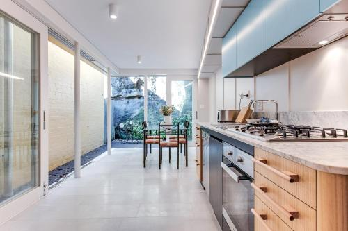 A kitchen or kitchenette at Renovated terrace in the heart of historic Sydney