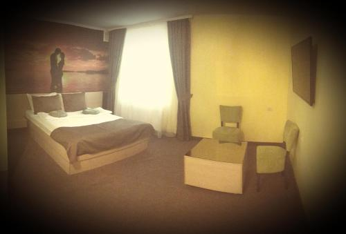 A bed or beds in a room at AMBER Hotel & Cafe