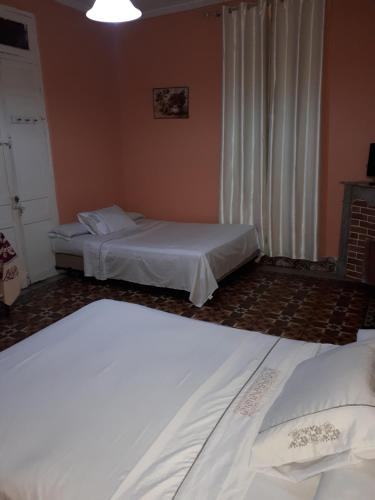 A bed or beds in a room at Pension Safari