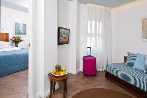 Een zitgedeelte bij U Coral Beach Club Eilat – Ultra All inclusive