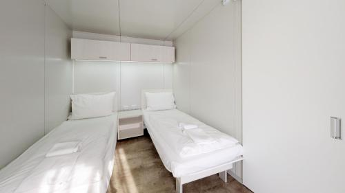 A bed or beds in a room at JUFA Hotel Vulkan Thermen- Resort