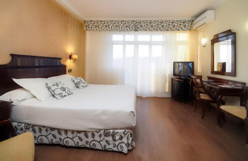 A bed or beds in a room at Rias Bajas