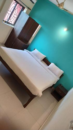 A bed or beds in a room at calangute dorz