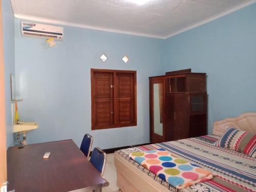 Ein Bett oder Betten in einem Zimmer der Unterkunft Thalia Homestay