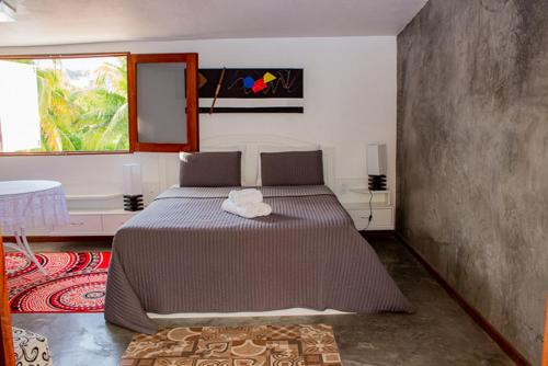 A bed or beds in a room at Hotel Pousada Mangrovia
