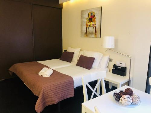 A bed or beds in a room at Barcelona Fifteen Luxury Aparthotel