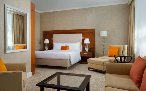 A bed or beds in a room at Marriott Moscow Hotel Novy Arbat
