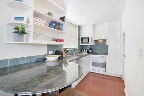 A kitchen or kitchenette at King size studio with water view, walk to the city