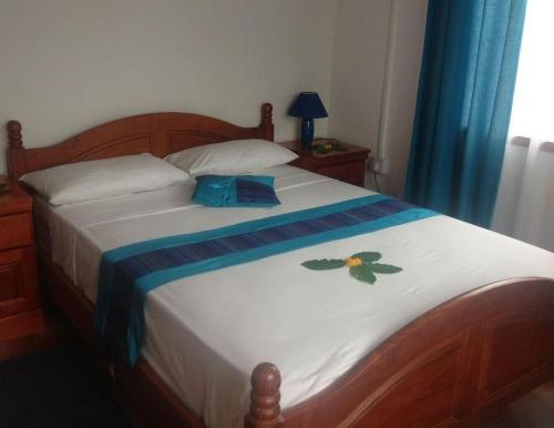 Кровать или кровати в номере Seashell Self Catering