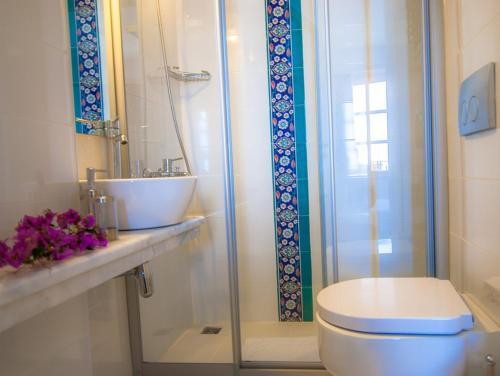 Ванная комната в Hotel Begonvil