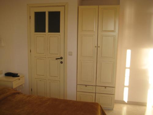 Кровать или кровати в номере Hotel Begonvil