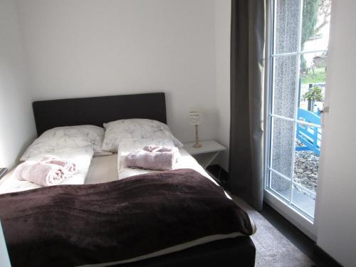 Ein Bett oder Betten in einem Zimmer der Unterkunft Haus Kummer Strandweg