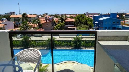 A view of the pool at Condominio laguna beach flat or nearby