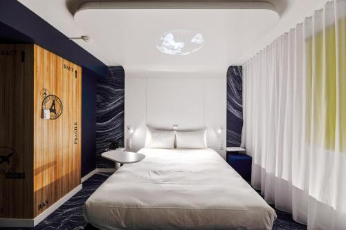A bed or beds in a room at ibis Styles Paris Orly Tech Airport