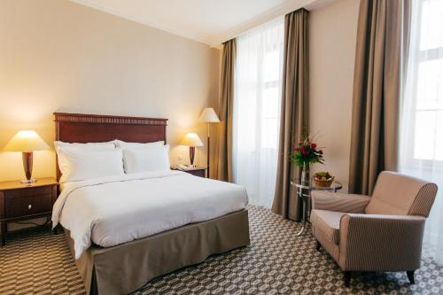 Un ou plusieurs lits dans un hébergement de l'établissement Radisson Blu Carlton Hotel, Bratislava