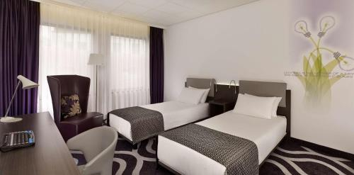 A bed or beds in a room at Park Plaza Eindhoven
