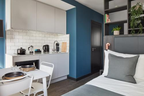 A kitchen or kitchenette at The Collective Canary Wharf