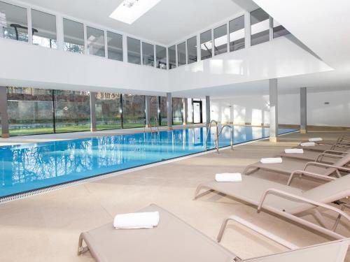 The swimming pool at or near DORMERO Strandhotel Rügen