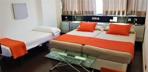 A bed or beds in a room at Fira Congress