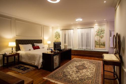 Cama ou camas em um quarto em Hotel Solar do Império