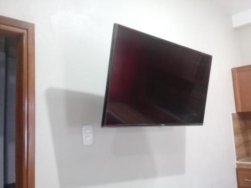 A television and/or entertainment centre at Bello Oriente II