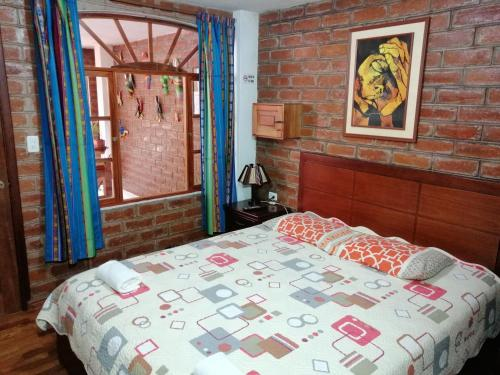 A bed or beds in a room at Hostal D´Mathias