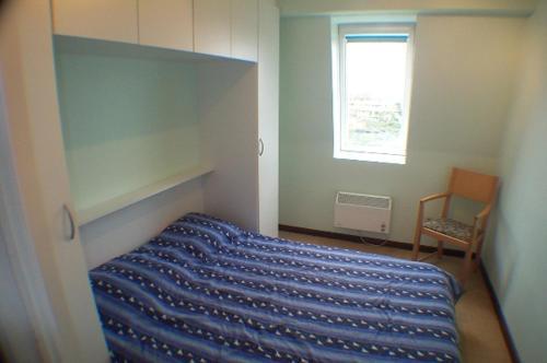 Ein Bett oder Betten in einem Zimmer der Unterkunft Residentie Koksijde promenade