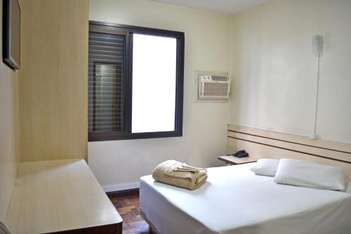 A bed or beds in a room at Colossi Hotel